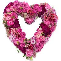 Rouwarrangement open hart vorm roze bloemen