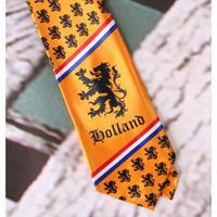 Oranje stropdas met kleine leeuwtjes