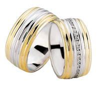 Christian Trouwringen bicolor diamanten rondom geel goud