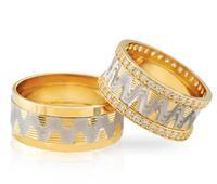Christian Diamanten trouwringen met golvende lijnen geel goud