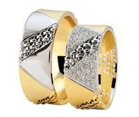 Christian Bicolor trouwringen diagonaal torsringen geel goud