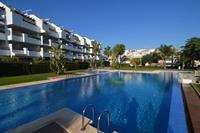 Appartement met zeezicht en grote tuin en zwembad