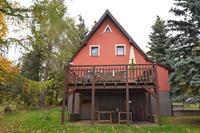 Vrijstaande vakantiewoning met groot terras en tafeltennistafel in het Ertsgebergte
