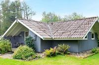 Vrijstaand vakantiehuis in Oksbøl met houtkachel
