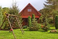 Charmant houten chalet in de bossen van Kopalino