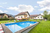 Verzorgde woning op heerlijk rustig woonerf met een zwembad