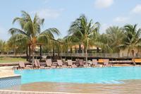 Modern appartement omringd door tropische tuin met zwembad vlakbij Mambo Beach