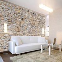 Fotobehang - Muur van kiezelstenen
